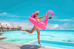 Free Happy Fun Luxury Hotel Vacation Woman Jumping Of Joy Taking Selfie With Pink Inflatable Swimming Pool Mattress At Stock Images - 215389634