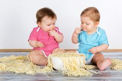 Happy fun messy eaters Stock Photos