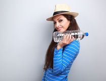 Happy fun young woman holding bottle of pure water with natural Stock Photos