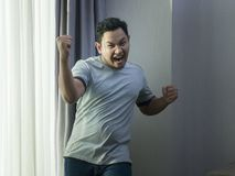 Happy Funny Asian Man Dancing Full of Joy stock photo
