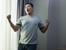 Happy Funny Asian Man Dancing Full of Joy royalty free stock image