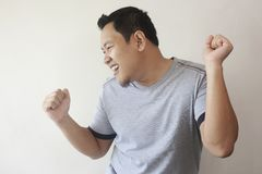 Happy Funny Asian Man Dancing Full of Joy stock photos