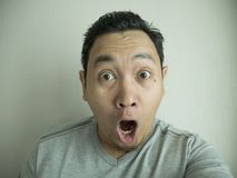 Happy Funny Asian Man Laughing at Camera royalty free stock image