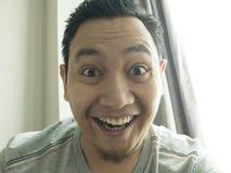 Happy Funny Asian Man Laughing at Camera royalty free stock images