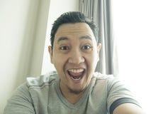 Happy Funny Asian Man Laughing at Camera stock photography