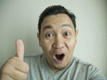 Happy Funny Asian Man Laughing at Camera stock images