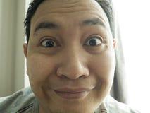 Happy Funny Asian Man Laughing at Camera stock photo