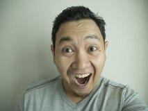 Happy Funny Asian Man Laughing at Camera royalty free stock photo