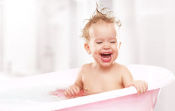 Happy funny  baby  laughing and bathed in bath Royalty Free Stock Photography