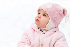 Happy funny baby in winter park Stock Photo