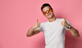 Happy funny boyfriend show sight thumbs up and good luck stock photos