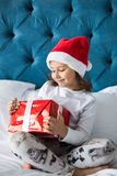 Pretty funny child girl with gifts in bed on Christmas morning. Happy funny child girl with gifts in bed on Christmas morning royalty free stock photos