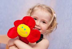 Happy funny child. Happy funny little girl with a flower stock photo