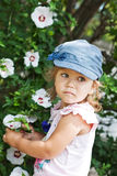 Happy funny child. Happy funny little girl with a flower royalty free stock images