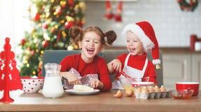 Happy children bake christmas cookies stock photo