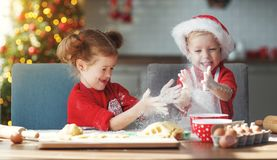 Happy children bake christmas cookies stock image