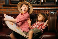Happy funny children. Two boys are playing at home to travelers. Childhood. Fantasy, imagination stock photography