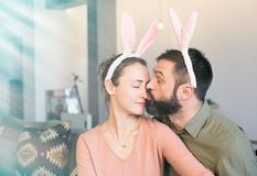 Happy and funny easter day. Beautiful young loving couple wearing rabbit bunny ears costume. Happy and funny easter day. Beautiful young loving couple wearing royalty free stock photography