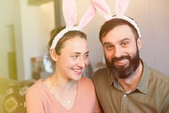 Happy and funny easter day. Beautiful young loving couple wearing rabbit bunny ears costume. Happy and funny easter day. Beautiful young loving couple wearing royalty free stock photos