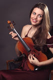 Happy and funny expression of a beautiful musician Royalty Free Stock Images