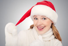 Happy funny girl in a Christmas hat Royalty Free Stock Images