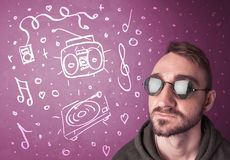Happy funny guy with shades and hand drawn media icons Royalty Free Stock Image
