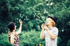 Couple blowing bubbles outdoor stock photography