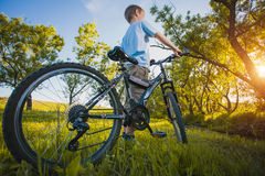 Happy funny kid on bicycle. Active Leisure Stock Images