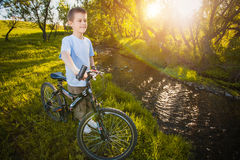 Happy funny kid on bicycle. Active Leisure Stock Photo