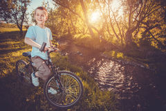 Happy funny kid on bicycle. Active Leisure Royalty Free Stock Images