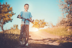 Happy funny kid on bicycle. Active Leisure Royalty Free Stock Photo