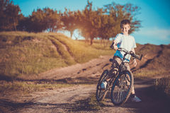 Happy funny kid on bicycle. Active Leisure Stock Image
