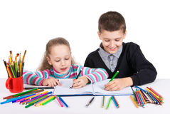 Happy funny kids draw. The boy and the girl draws pencils. Creativity concept. Stock Photo