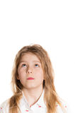Happy funny little girl looking up on copyspace. Happy funny little girl headshot looking up on copyspace isolated on white background Stock Photos