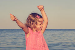 Happy, funny little girl on sea. Selective focus. Royalty Free Stock Photo