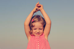 Happy, funny little girl on sea. Selective focus. Stock Photo