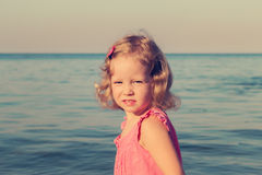 Happy, funny little girl on sea. Selective focus. Stock Photography