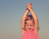 Happy, funny little girl on sea. Selective focus. Royalty Free Stock Images