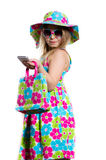 Happy funny little girl smiling and holding mobile Royalty Free Stock Photography