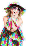 Happy funny little girl smiling and looking surprised Stock Photography