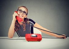 Happy funny looking young woman calling someone. Happy funny looking woman calling someone on the phone Royalty Free Stock Photography