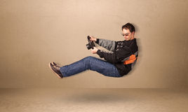 Happy funny man driving a flying car concept Royalty Free Stock Photography