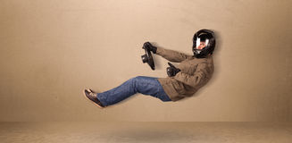 Happy funny man driving a flying car concept Stock Photography