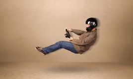 Happy funny man driving a flying car concept Royalty Free Stock Photos