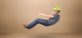 Happy funny man driving a flying car concept Stock Photo