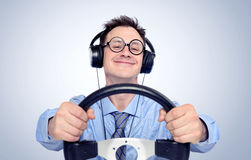 Happy funny man with glasses and headphones while driving car Stock Images