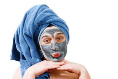 Happy funny man with mask for skin, man sends an air kiss, man likes to make a mask for the skin, blue towel on the head, man royalty free stock image