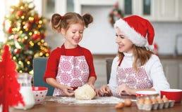 Happy family bake christmas cookies royalty free stock photos
