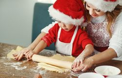 Happy family bake christmas cookies. Happy funny mother and child bake christmas cookies stock images