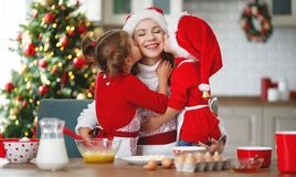 Happy family bake christmas cookies. Happy funny mother and children bake christmas cookies stock images